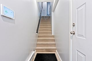 """Photo 4: 8 6033 168 Street in Surrey: Cloverdale BC Townhouse for sale in """"Chestnut"""" (Cloverdale)  : MLS®# R2621139"""