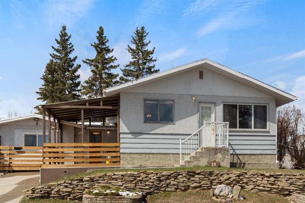 Main Photo: 39 Glacier Drive SW in Calgary: Glamorgan Detached for sale : MLS®# A1098694