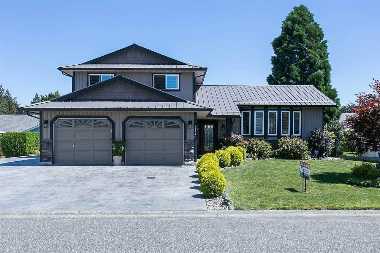 """Main Photo: 6940 COACH LAMP Drive in Chilliwack: Sardis West Vedder Rd House for sale in """"WELLS LANDING"""" (Sardis)  : MLS®# R2093207"""