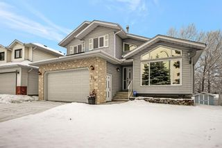 Photo 1: 210 Hawktree Bay NW in Calgary: Hawkwood Detached for sale : MLS®# A1062058