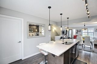 Photo 23: 111 Evanscrest Gardens NW in Calgary: Evanston Row/Townhouse for sale : MLS®# A1135885