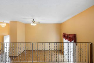 Photo 16: 128 Dovertree Place SE in Calgary: Dover Semi Detached for sale : MLS®# A1075565