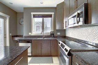 Photo 9: 47 WEST SPRINGS Lane SW in Calgary: West Springs Row/Townhouse for sale : MLS®# A1039919