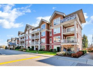 "Photo 1: 408 6440 194 Street in Surrey: Clayton Condo for sale in ""WATERSTONE"" (Cloverdale)  : MLS®# R2441400"