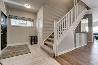 Photo 4: 129 HEARTLAND Way: Cochrane House for sale : MLS®# C4170251
