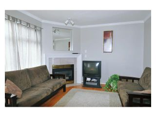 Photo 2: 26 2538 PITT RIVER Road in Port Coquitlam: Mary Hill Townhouse for sale : MLS®# V863108