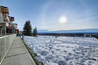 Photo 2: 19 117 Rockyledge View NW in Calgary: Rocky Ridge Row/Townhouse for sale : MLS®# A1061525