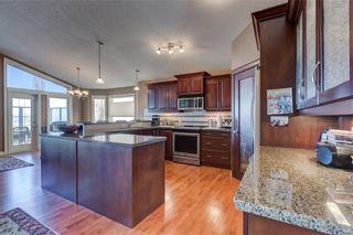 Photo 7: 206 GLENEAGLES View: Cochrane House for sale : MLS®# C4181281