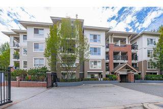 """Photo 1: B403 8929 202 Street in Langley: Walnut Grove Condo for sale in """"THE GROVE"""" : MLS®# R2612909"""