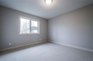 Photo 22: 242 STRATHRIDGE Place SW in Calgary: Strathcona Park Detached for sale : MLS®# C4246259