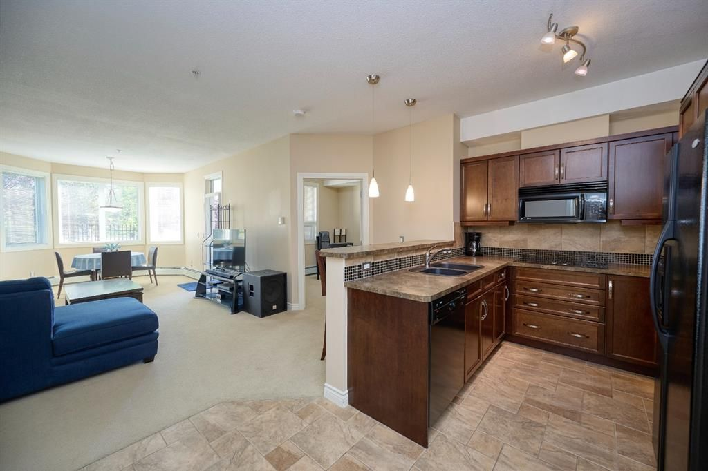 Main Photo: 112 26 Val Gardena View SW in Calgary: Springbank Hill Apartment for sale : MLS®# A1145110