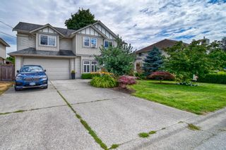 Photo 1: 12224 194A Street in Pitt Meadows: Mid Meadows House for sale : MLS®# R2608579