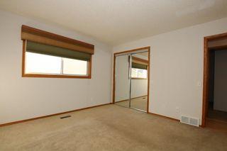 Photo 18: 22 WEST COPITHORNE Place: Cochrane House for sale : MLS®# C4121744