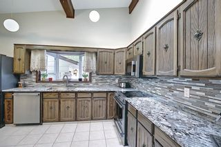 Photo 12: 335 Queensland Place SE in Calgary: Queensland Detached for sale : MLS®# A1137041