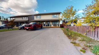 Photo 1: 8810 76 Street in Fort St. John: Fort St. John - City SE 1/2 Duplex for sale (Fort St. John (Zone 60))  : MLS®# R2620335