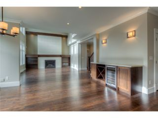 Photo 4: 720 COMO LAKE Avenue in Coquitlam: Coquitlam West House for sale : MLS®# V1072916