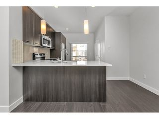 """Photo 4: 81 5888 144 Street in Surrey: Sullivan Station Townhouse for sale in """"One44"""" : MLS®# R2563940"""