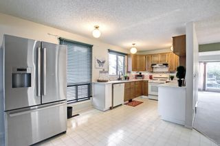 Photo 8: 36 Strathearn Crescent SW in Calgary: Strathcona Park Detached for sale : MLS®# A1152503