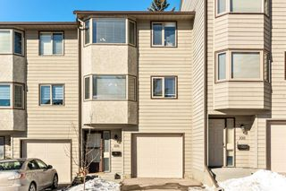 Photo 1: 108 Glamis Terrace SW in Calgary: Glamorgan Row/Townhouse for sale : MLS®# A1070053