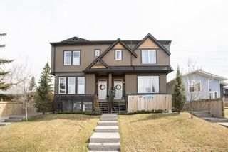 Photo 1:  in Calgary: Winston Heights/Mountview Row/Townhouse for sale : MLS®# A1105103