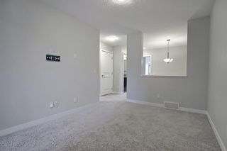 Photo 29: 102 Clydesdale Way: Cochrane Row/Townhouse for sale : MLS®# A1117864