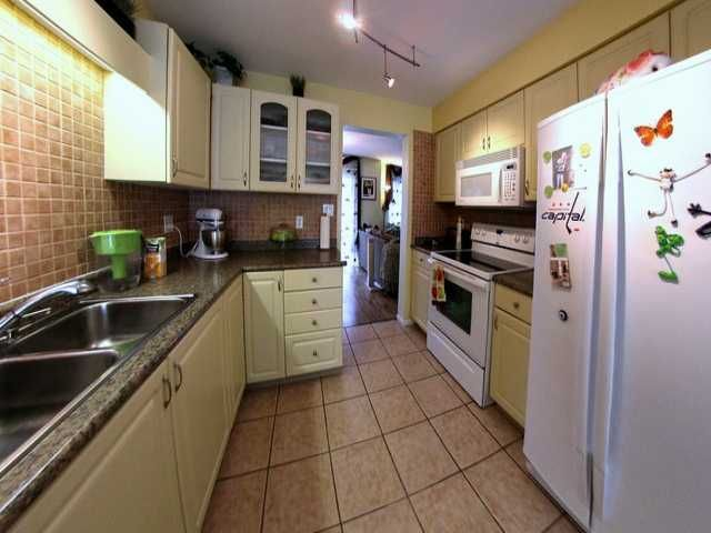"""Photo 5: Photos: 107 8655 KING GEORGE Boulevard in Surrey: Queen Mary Park Surrey Townhouse for sale in """"Creekside Village"""" : MLS®# F1305192"""