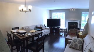 """Photo 1: 207 13727 74 Avenue in Surrey: East Newton Condo for sale in """"King's Court"""" : MLS®# R2376158"""