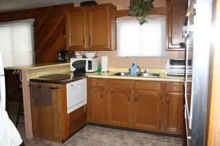 Photo 2: 264 Spring Haven Court SE: Airdrie Detached for sale : MLS®# A1084823