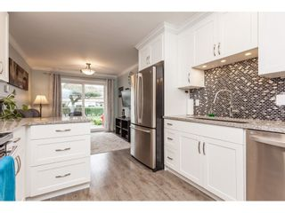 """Photo 8: 136 5641 201 Street in Langley: Langley City Townhouse for sale in """"The Huntington"""" : MLS®# R2409027"""