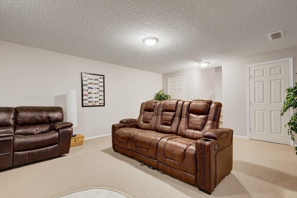 Photo 22: Photos: 32 INVERNESS Boulevard SE in Calgary: McKenzie Towne House for sale : MLS®# C4175544