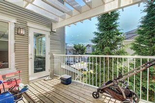 Photo 12: 504 281 Cougar Ridge Drive SW in Calgary: Cougar Ridge Row/Townhouse for sale : MLS®# A1123514