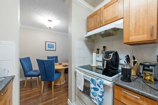 """Photo 15: 217 1850 E SOUTHMERE Crescent in Surrey: Sunnyside Park Surrey Condo for sale in """"SOUTHMERE PLACE"""" (South Surrey White Rock)  : MLS®# R2603585"""