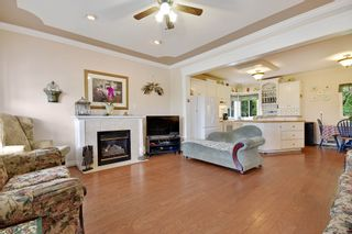 """Photo 2: 35679 TIMBERLANE Drive in Abbotsford: Abbotsford East House for sale in """"MOUNTAIN VILLAGE"""" : MLS®# R2393387"""
