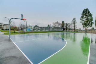 "Photo 19: 102 2295 PANDORA Street in Vancouver: Hastings Condo for sale in ""Pandora Gardens"" (Vancouver East)  : MLS®# R2542611"