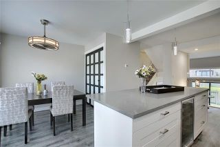Photo 7: 18 23 GLAMIS Drive SW in Calgary: Glamorgan Row/Townhouse for sale : MLS®# C4293162