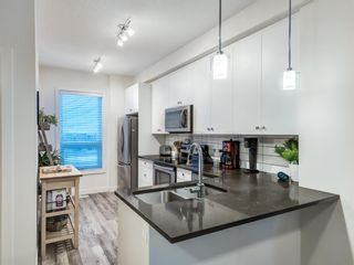 Photo 6: 402 11 Evanscrest Mews NW in Calgary: Evanston Row/Townhouse for sale : MLS®# A1070182