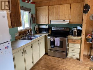Photo 15: 5273 CANIM-HENDRIX LAKE ROAD in 100 Mile House: House for sale : MLS®# R2616643