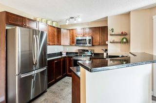 Photo 7: 7410 304 Mackenzie Way SW: Airdrie Apartment for sale : MLS®# A1149163
