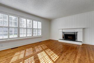 Photo 8: 7311 11 Street SW in Calgary: Kelvin Grove Detached for sale : MLS®# A1049038