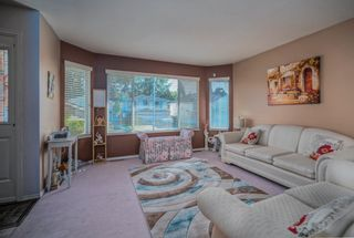 Photo 3: 19383 CUSICK Crescent in Pitt Meadows: Mid Meadows House for sale : MLS®# R2617633