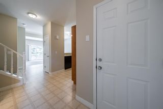 Photo 5: 404 720 Willowbrook Road NW: Airdrie Row/Townhouse for sale : MLS®# A1098346