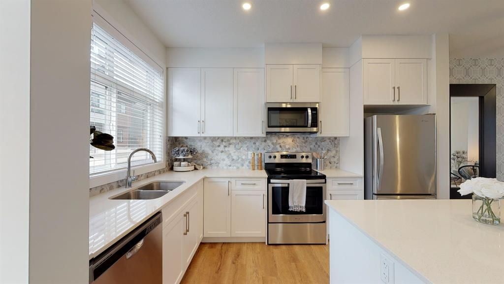 Photo 1: Photos: 122 Sage Meadows Garden NW in Calgary: Sage Hill Row/Townhouse for sale : MLS®# A1072303