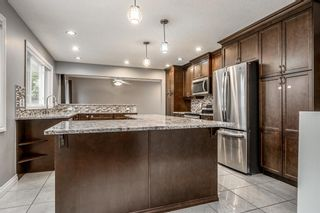 Photo 9: 1412 29 Street NW in Calgary: St Andrews Heights Detached for sale : MLS®# A1116002