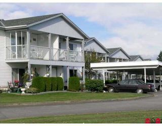 """Photo 1: 32691 GARIBALDI Drive in Abbotsford: Abbotsford West Townhouse for sale in """"CARRIAGE LANE"""" : MLS®# F2626920"""