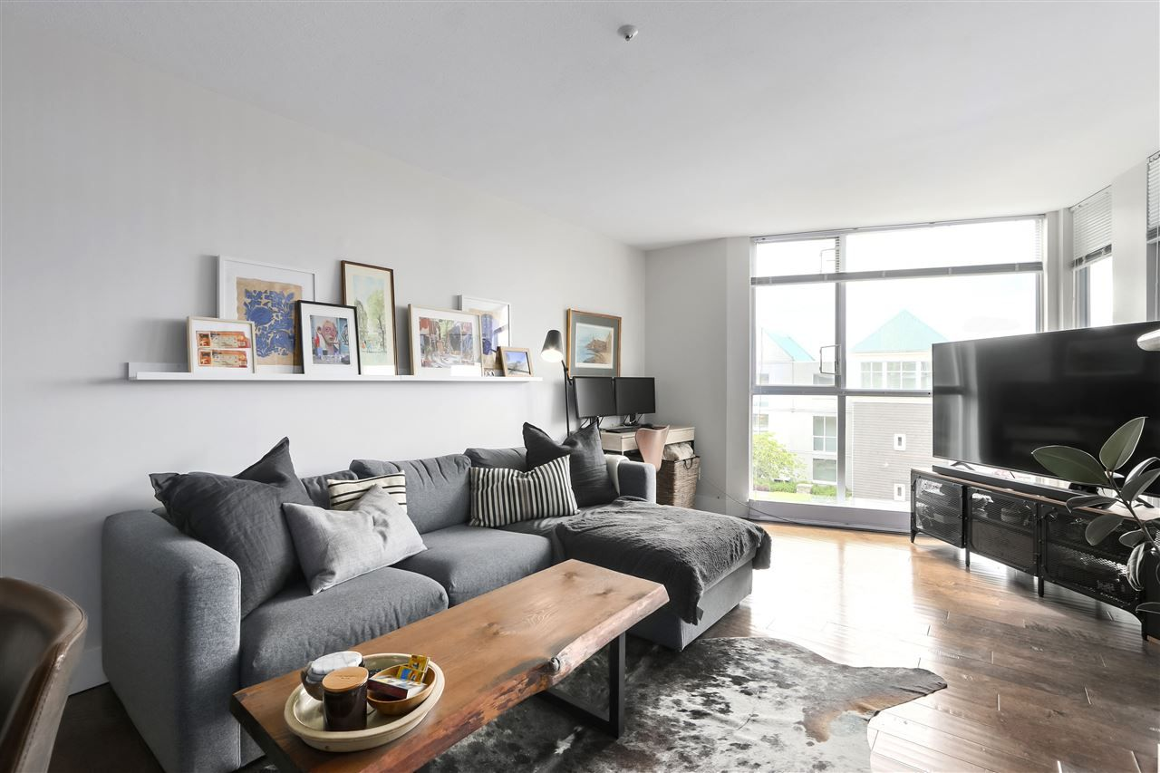 """Main Photo: 210 8430 JELLICOE Street in Vancouver: South Marine Condo for sale in """"BOARDWALK"""" (Vancouver East)  : MLS®# R2453487"""
