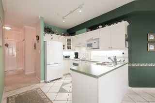 "Photo 11: 212 3098 GUILDFORD Way in Coquitlam: North Coquitlam Condo for sale in ""MARLBOROUGH HOUSE"" : MLS®# R2225808"
