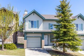 Photo 1: 85 Hidden Creek Rise NW in Calgary: Hidden Valley Row/Townhouse for sale : MLS®# A1104213