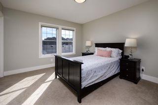 Photo 15: 524 Quarry Park Boulevard SE in Calgary: Douglasdale/Glen Row/Townhouse for sale : MLS®# A1084098