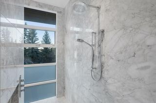Photo 34: 106 Pumpridge Place SW in Calgary: Pump Hill Detached for sale : MLS®# A1092550