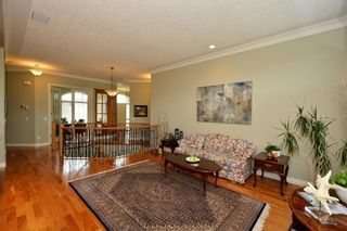 Photo 10: 104 GLENEAGLES Landing: Cochrane House for sale : MLS®# C4127159